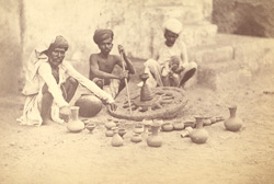 Potter at work, showing method of spinning the wheel, Ahmadabad